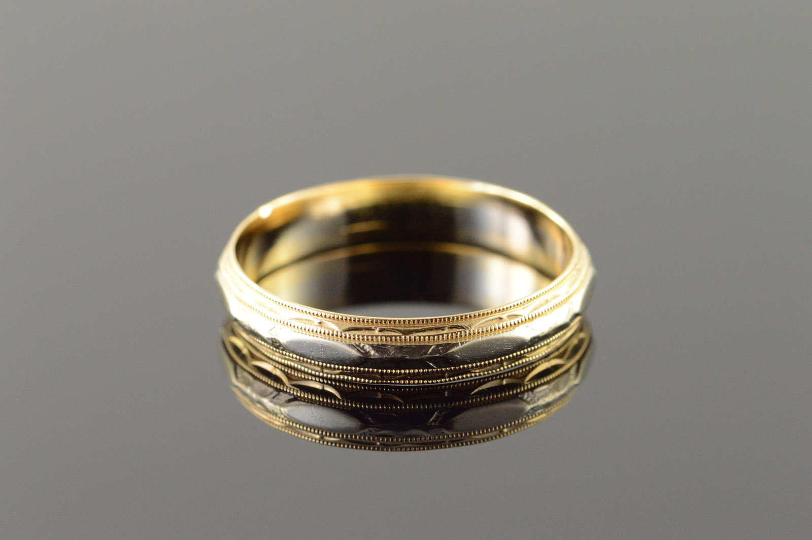 mens modern organic two tone wedding band two tone wedding band Mens Modern Organic Two Tone Wedding Band in 18K recycled gold with twig detail in center