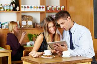 couple looking at tablet-content consumption
