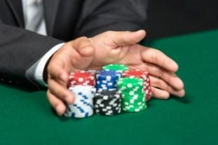 hands pushing poker chips