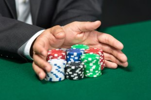 hands pushing poker chips