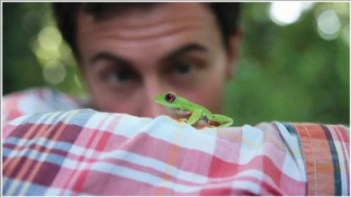 man's face-frog on arm