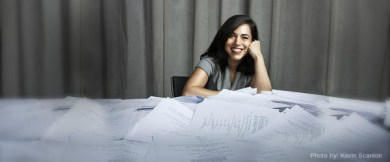 smiling woman-paper-covered table