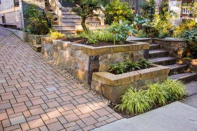 Eric Contey Stonework - Giraud terraced retaining wall with permeable paver driveway