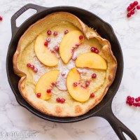 Vanilla Dutch Baby Pancake with Red Currants and Peaches