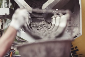 Concrete mix and worker's hand