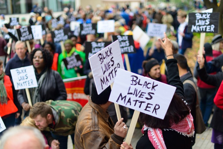 Ithacans take to the streets Saturday to march as part of the Black Lives Matter movement (David Navadeh / Sun Staff Photographer).