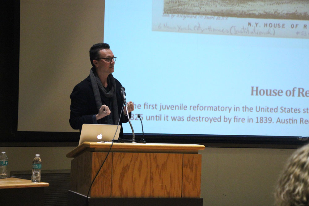 Prof. Caleb Smith, Yale University, presents the life and memoir of Austin Reed — a prisoner, indentured servant and writer — in Goldwin Smith Hall yesterday. (Greg Keller / Sun Staff Photographer)