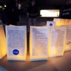 Luminaries with statements of solidarity for hazing victims are arranged in a semicircle at the alpha Kappa Delta Phi Hazing remembrance vigil on Ho Plaza. (Connor Smith / Sun Contributor)