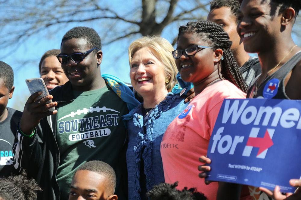 Presidential hopeful Hillary Clinton takes a photo with voters in Raleigh, N.C. on Tuesday.