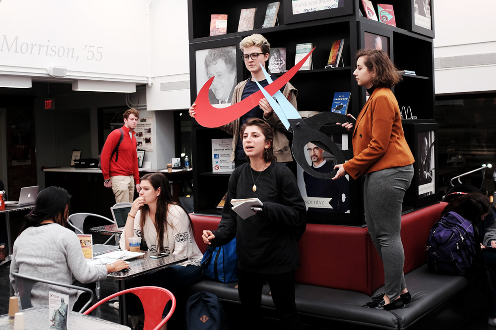 Cornell Organization for Labor Action members protest Nike's labor practices at the Cornell Store on Thursday.