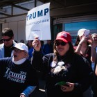 Trump supporters face protestors outside their candidate's rally in Syracuse this spring.