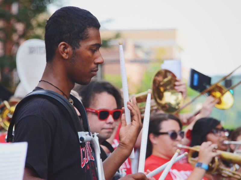 Students hear about opportunities for volunteering at Cornell and Ithaca at Tuesday's annual BEAR walk.