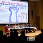 "Cornell faculty speak at a ""Freedom Interrupted"" lecture in Klarman Atrium on Wednesday."