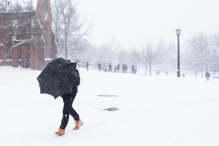 Student walks in front of Sage Chapel during Storm Stella on March 14, 2017. (Michael Suguitan/ Sun Staff Photographer)