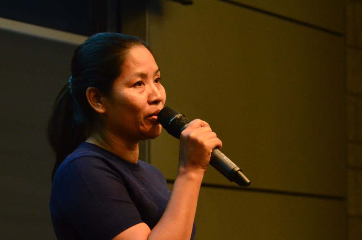 Sophorn Yang, former garment worker and head of the largest labor union in Cambodia, speaks to a crowd in Ives Hall on Tuesday afternoon.