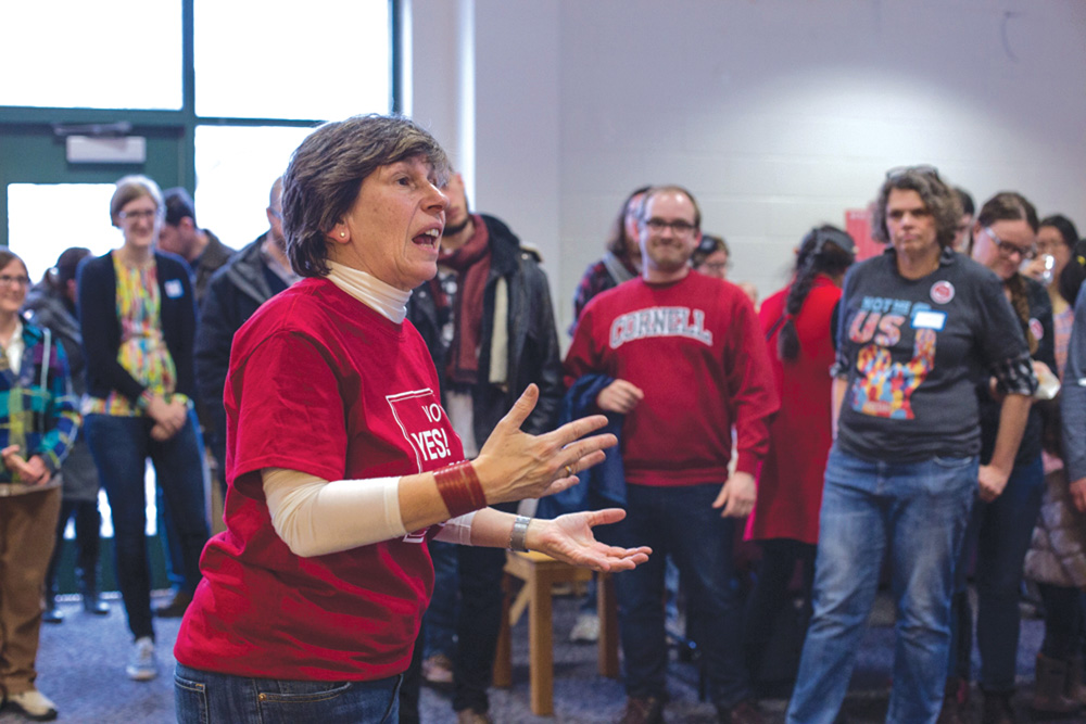 From a rally on Saturday, AFT President Randi Weingarten '80 speaks to a crowd of graduate students.