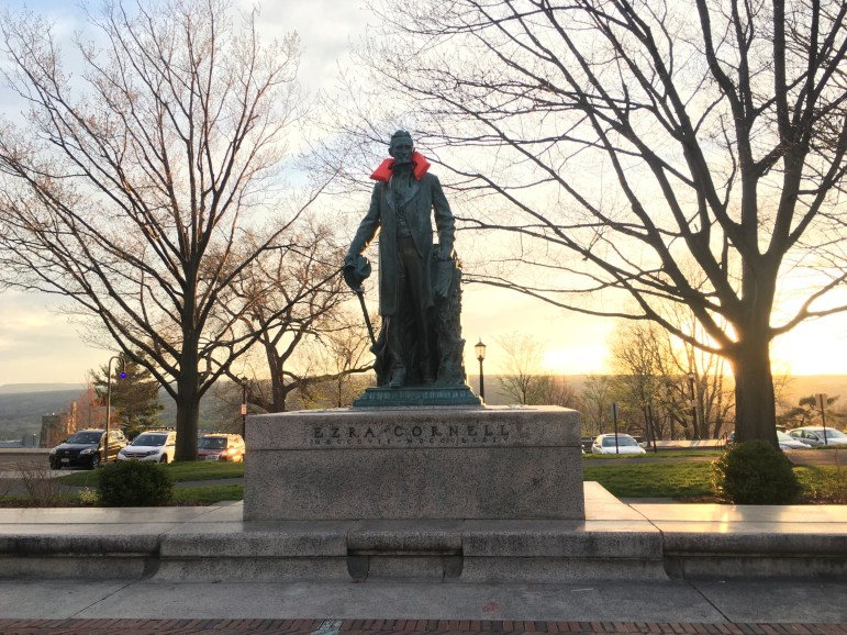 A life jacket wrapped around a statue of Ezra Cornell on the Arts Quad late on Sunday evening as part of the Week of Action for Refugees