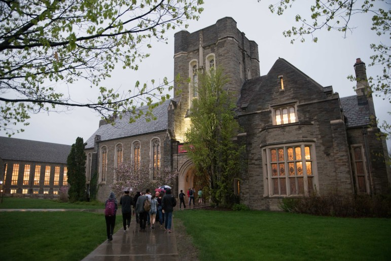 Pro-Palestine protesters marched from Goldwin Smith Hall to Anabel Taylor Hall on Monday evening to protest a Cornell Hillel event celebrating Israel Independence Day.