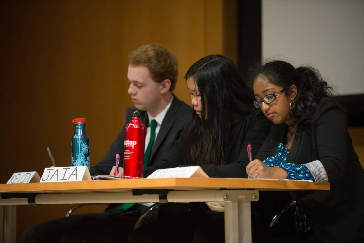 The Cornell Democrats prepare during Tuesday's debate.