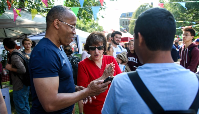 President Pollack joins the festivities at the fair, taking selfies with community members.