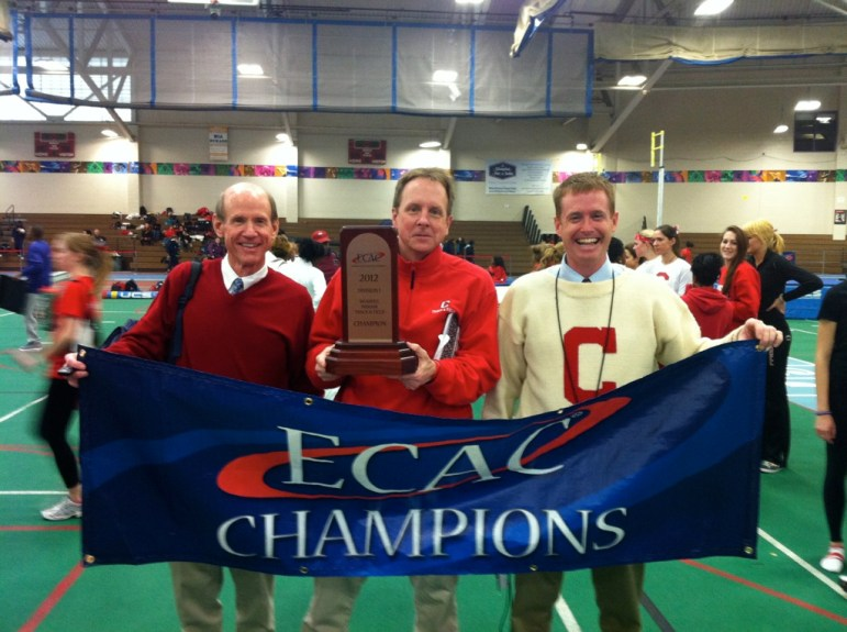 From left: former head coach Lou Duesing, Bowman and Smith celebrating the program's 2012 ECAC Indoor tiitle.