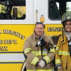 Fire Chief George Tamborelle and Meeta Shrivastava '19 of the Cayuga Heights Fire Department pose in front of a fire engine on Monday.