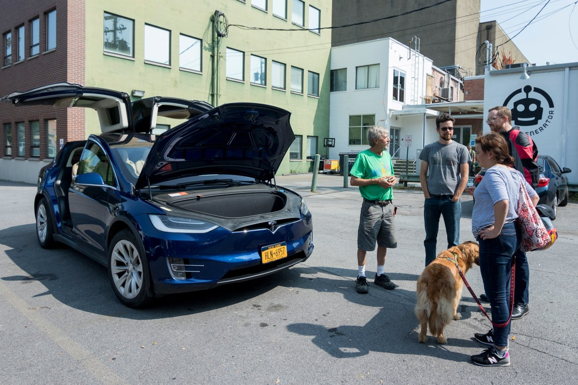 Electric vehicle owners in Ithaca demonstrate their cars at Saturday's event.