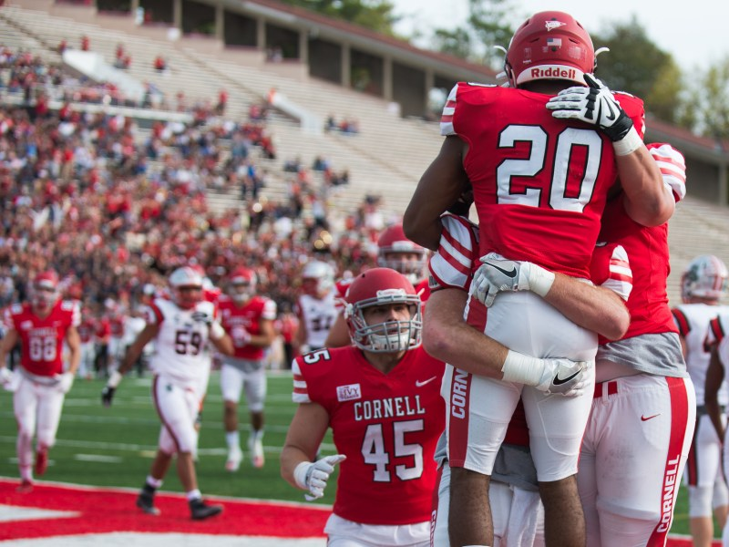 Sophomore running back Harold Coles (#20) celebrates one of his two touchdowns against Brown Saturday. The tailback had two touchdowns and 65 yards on the day.