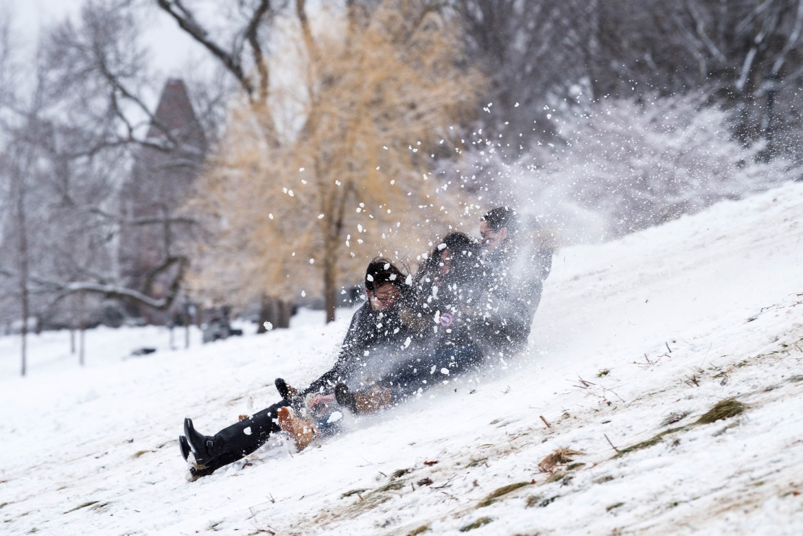 Students enjoy Friday's snow day as they sled down the Libe slope.