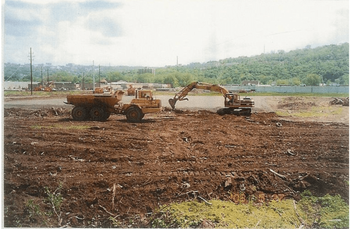A bulldozer works on reconstructing the former dump. The property was reported to have 1,515 gallons of 'solid waste' in 1986.