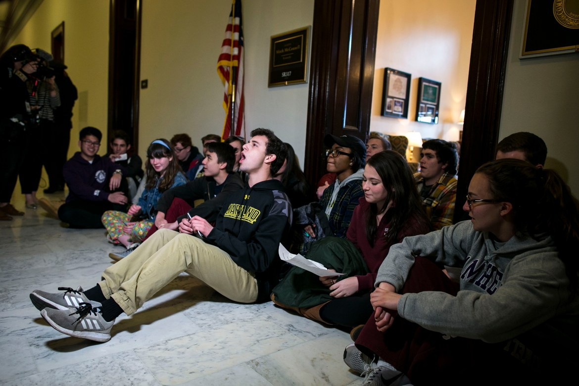 Students sit in protest outside the office of Senate Majority Leader Mitch McConnell (R-Ky.) on Capitol Hill in Washington, March 7, 2018. Turning away from any effort to pass comprehensive gun control legislation, Republican leaders are hoping that measures to beef up school security could quell the public uproar over the recent massacre in Parkland, Fla.