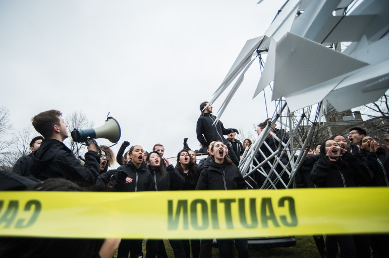 """First-year architecture students dressed in identical black hoodies and chanted """"oy, oy, oy"""" in response to repeated calls of """"dragon, dragon, dragon"""" by a captain."""