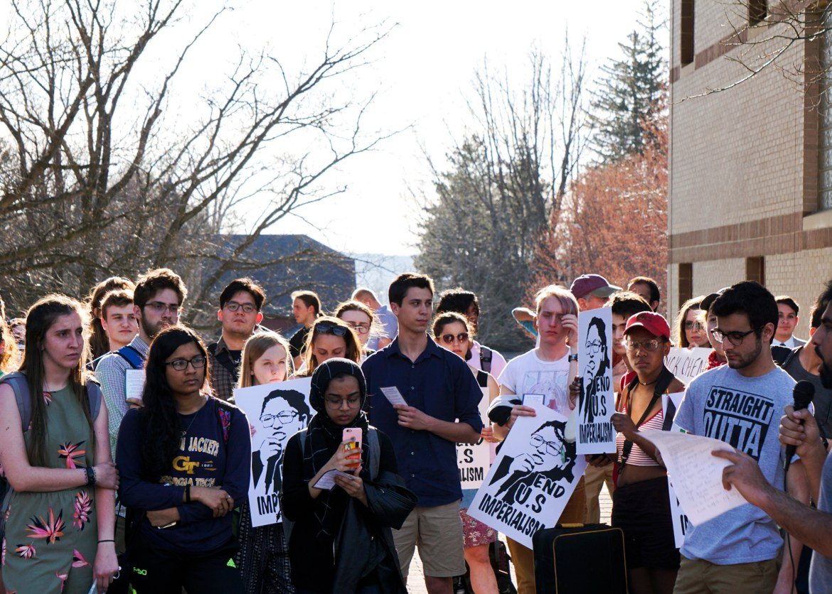 Students listen to speeches during the demonstration against Cheney.
