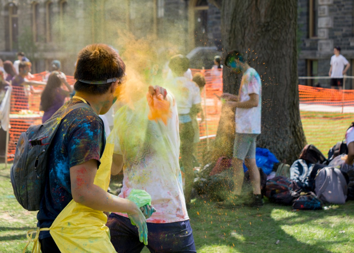 Students celebrate the annual Holi on the Arts Quad on Saturday.