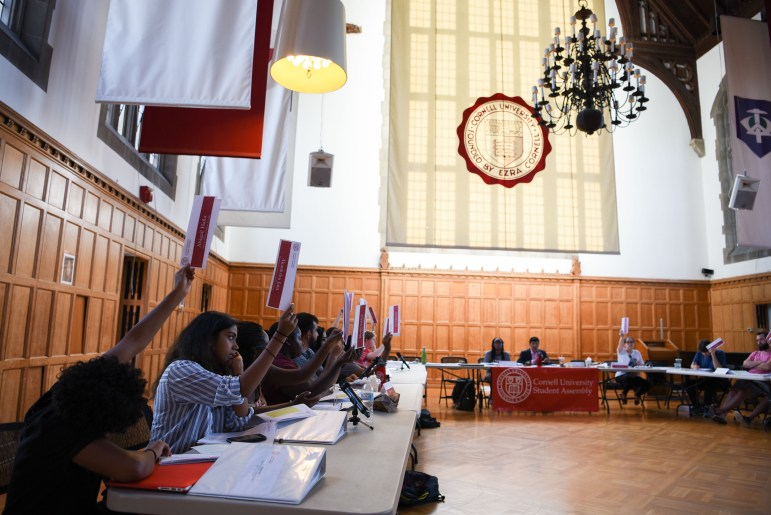Student Assembly members vote on a motion at their meeting on Thursday. During the meeting, the S.A. amended its bylaws to allow for the creation of an auditory body aimed at disqualifying shell organizations from receiving SAFC funding; they also voted against adding a vice president of infrastructure to the S.A. executive board.