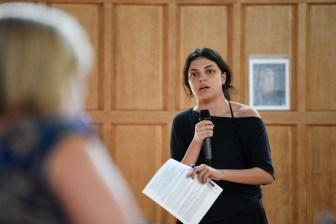 Zelia Gonzales '20, an audience member, confronts the administrators.