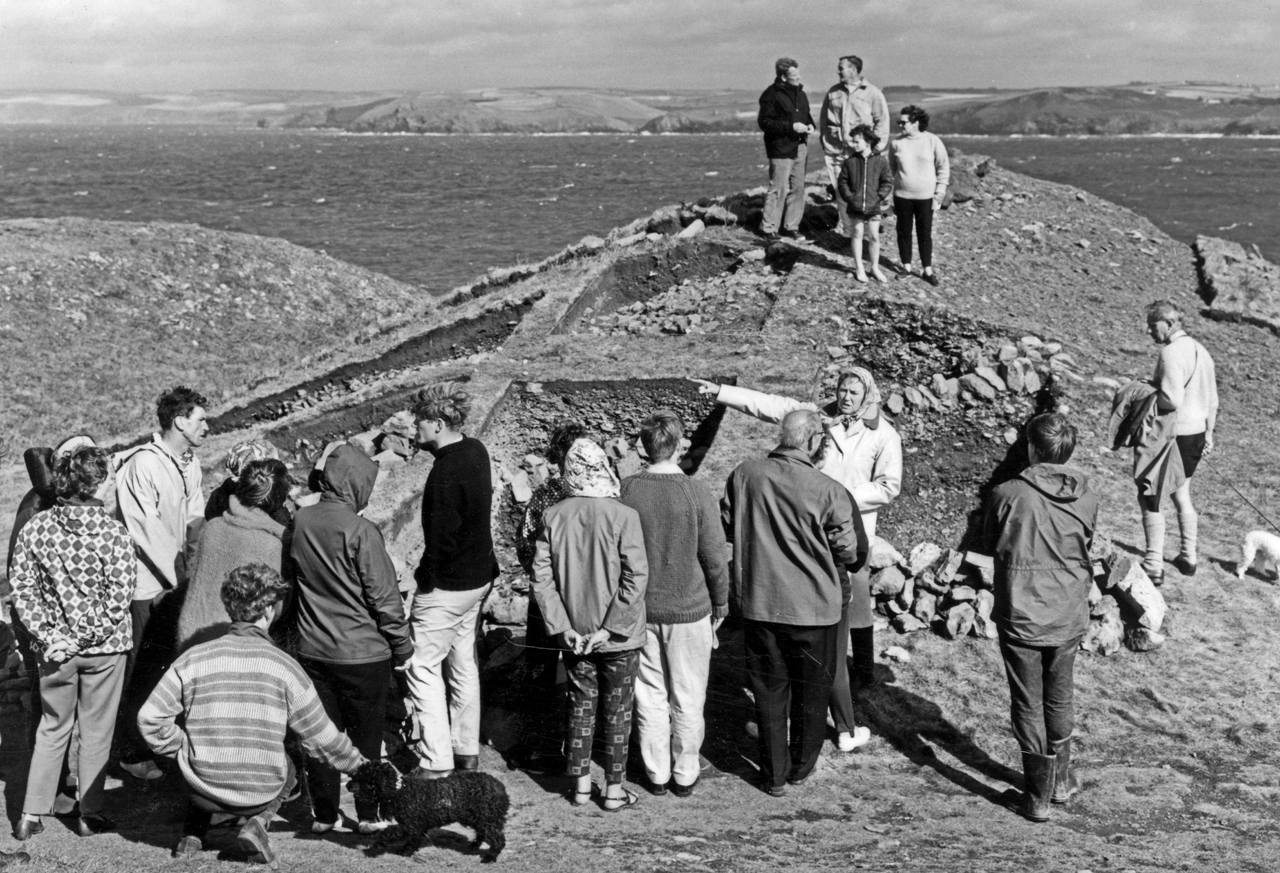 Members visit the excavation at the Rumps cliff castle
