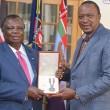 President Uhuru Congratulating COTU-K Secretary General Bro. Atwoli for his National Order of Merit Award given to him by Algeria President Abdelaziz Bouteflika