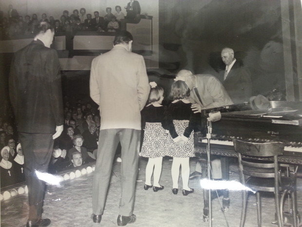 Christine McDonald (and sister) onstage with Jimmy Durante, band members and Father Z – Somerville, MA