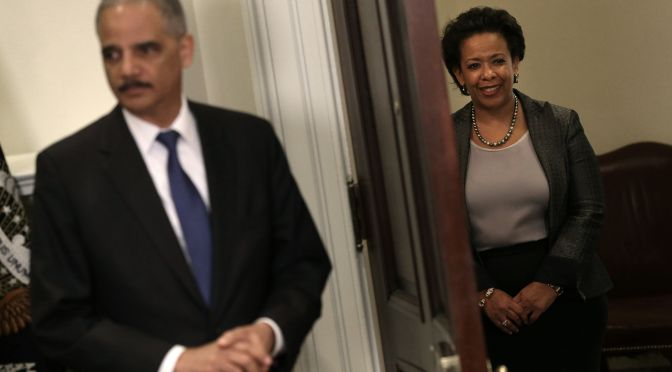 WASHINGTON, DC - NOVEMBER 08:  Attorney General nominee Loretta Lynch (R) listens as U.S. President Barack Obama answers a question after introducing her as his nominee to replace Eric Holder (L) following a ceremony in the Roosevelt Room of the White House November 8, 2014 in Washington, DC. Lynch has recently been the top U.S. prosecutor in Brooklyn, and would be the first African American woman to hold the position of Attorney General if confirmed.  (Photo by Win McNamee/Getty Images)