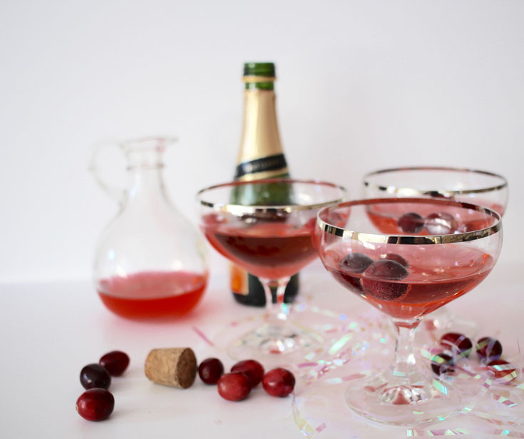 New Years Eve Cocktail champagne cranberry syrup vintage champagne flutes