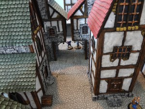 The view from a 2nd floor down a street lined with Custom Kingdoms buildings.