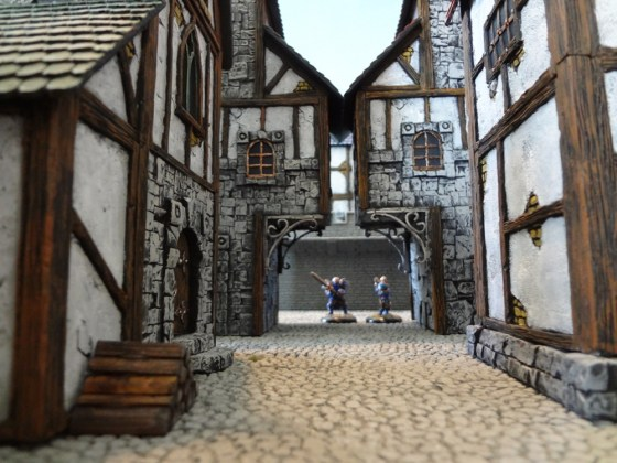 A view down a street lined with Custom Kingdoms miniature buildings.