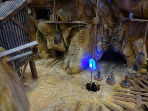 Glowing blue crystals illuminate a mining cave complex for Dark Age Games