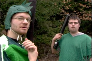 Two LARPers dressed up in green costumes as either lizardmen or finfolk