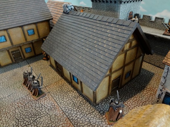 The 8 inch by 6 inch large prepainted miniature house from Pegasus Hobbies has a Tudor feel to it