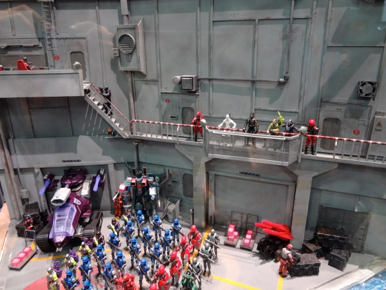 Diorama at the 2012 Hasbro booth at Comic-Con with GI Joe action figures lined up in a huge Cobra facility