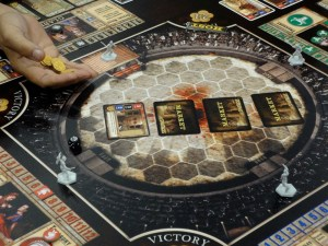 Unpainted plastic generic gladiator pieces on arena game board for Spartacus board game at Gen Con