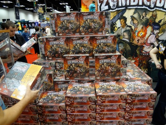 Boxes stacked head high at Cool Mini or Not's Gen Con Booth of Zombicide