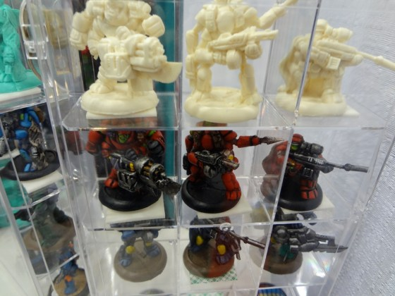 1:1 scale miniatures about 30mm tall in glass display case for Zynvaded game at Gen Con